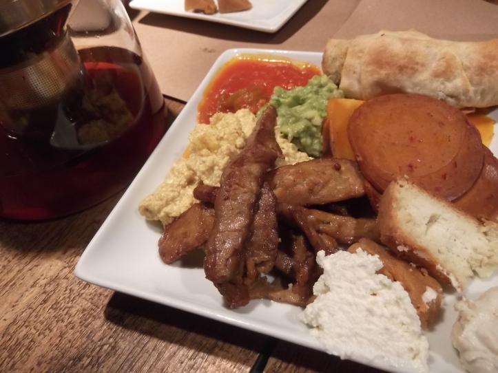 Tempeh Bacon, Tofu Scramble, Nut Cheeses, Mashed Avocado, Roasted Pumpkin, Tomato Sauce, and Seitan Salami