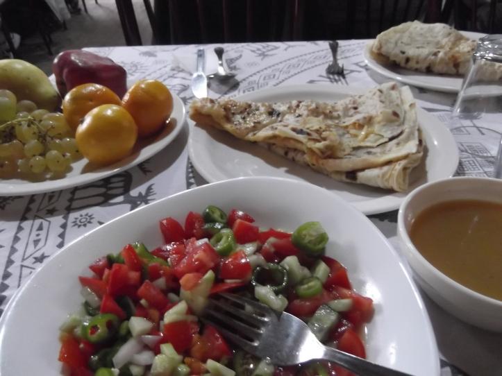 Gozleme bread, tarhana soup, fruits, and salad